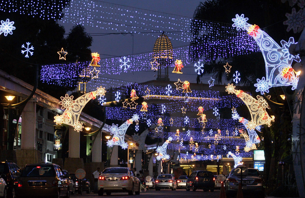Motorists drive through the Christmas decorations on display for the upcoming Christmas celebration in Petaling Jaya, near Kuala Lumpur, Malaysia, Friday, Dec. 11, 2009. (AP Photo/ Lai Seng Sin)